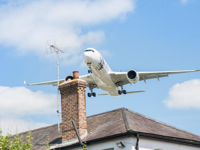 view of airplane and a house
